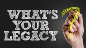 Hand writing the text: Whats Your Legacy?
